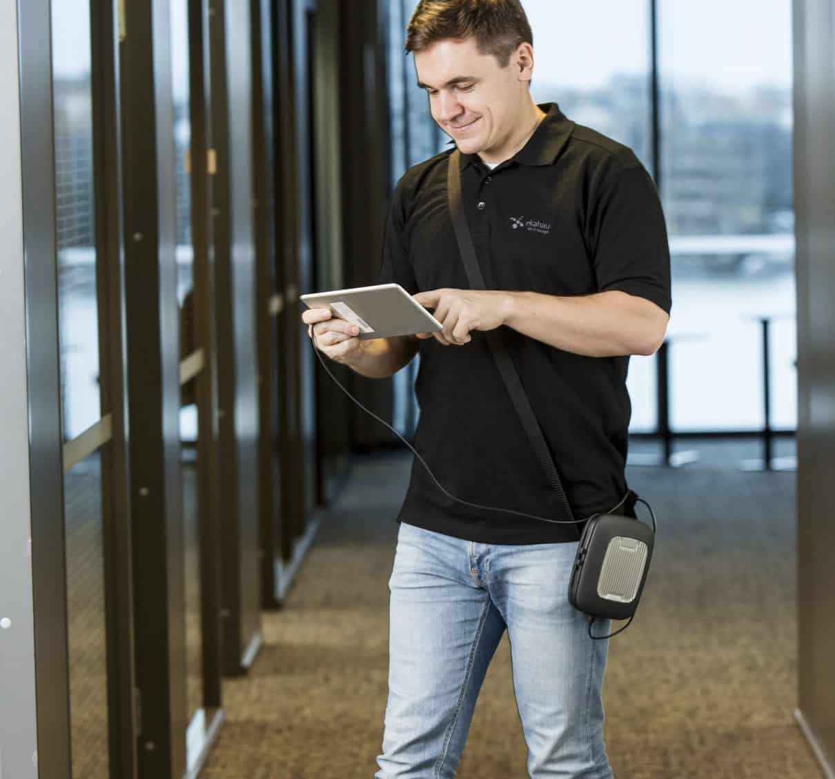Man with Ekahau Sidekick using tablet